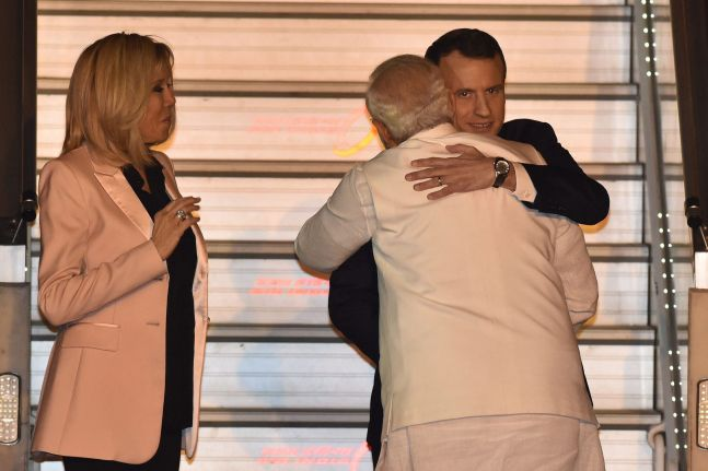 French President Emmanuel Macron lands in India, gets a PM Modi embrace