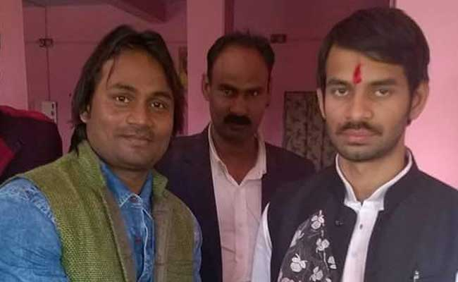 Alleged shooter Mohammad Kaif was photographed with Bihar minister Tej Pratap Yadav (right).