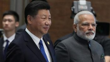 China hails 'new beginning stage' as Modi heads to Wuhan