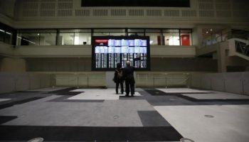 Asia shares blended, oil down in the midst of Syria aftermath