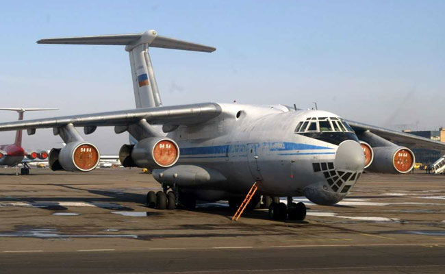 The aircraft is an Ilyushin II-76, which is capable of carrying around 120 passengers.