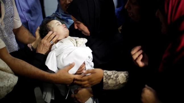 Gazans cover dead after bloodiest day of Israel outskirt challenges