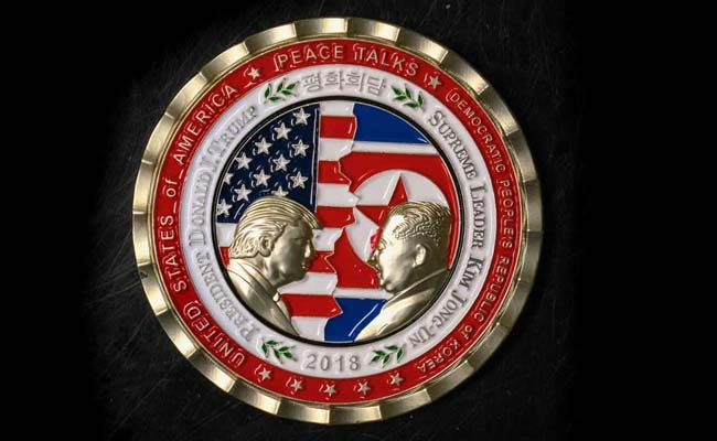 A commemorative coin featuring US President Donald Trump and North Korea's Kim Jong Un has been struck by the White House Communications Agency ahead of their summit meeting