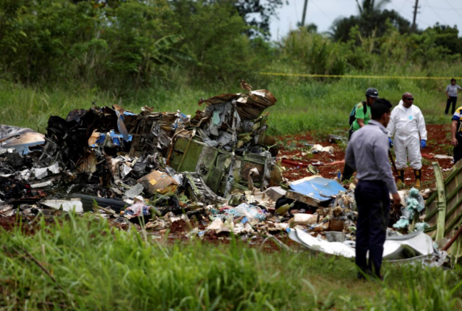 Rescue team members work in the wreckage of a Boeing 737.