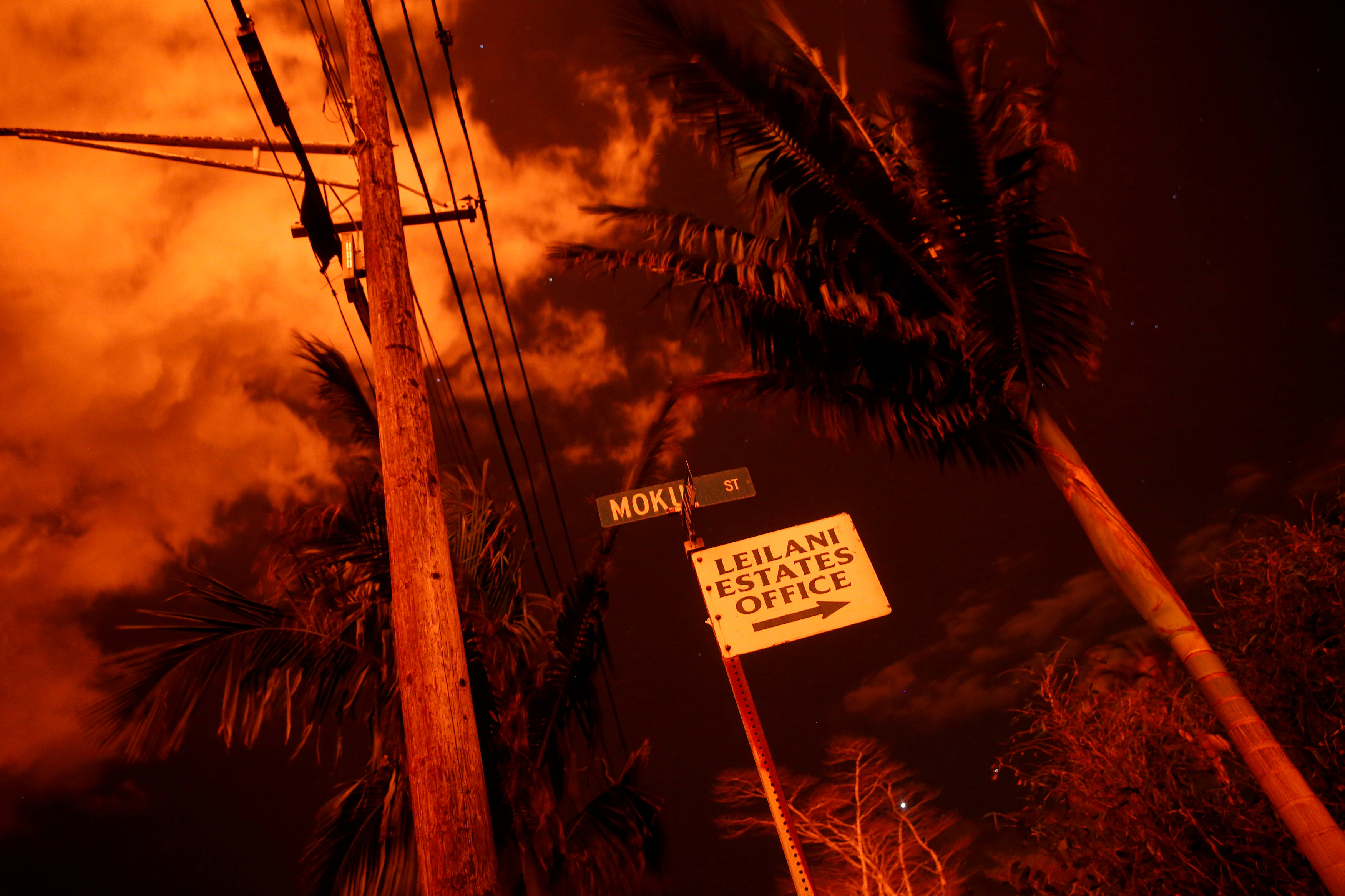 Lava illuminates a sign in Leilani Estates during ongoing eruptions of the Kilauea Volcano in Hawaii, US.