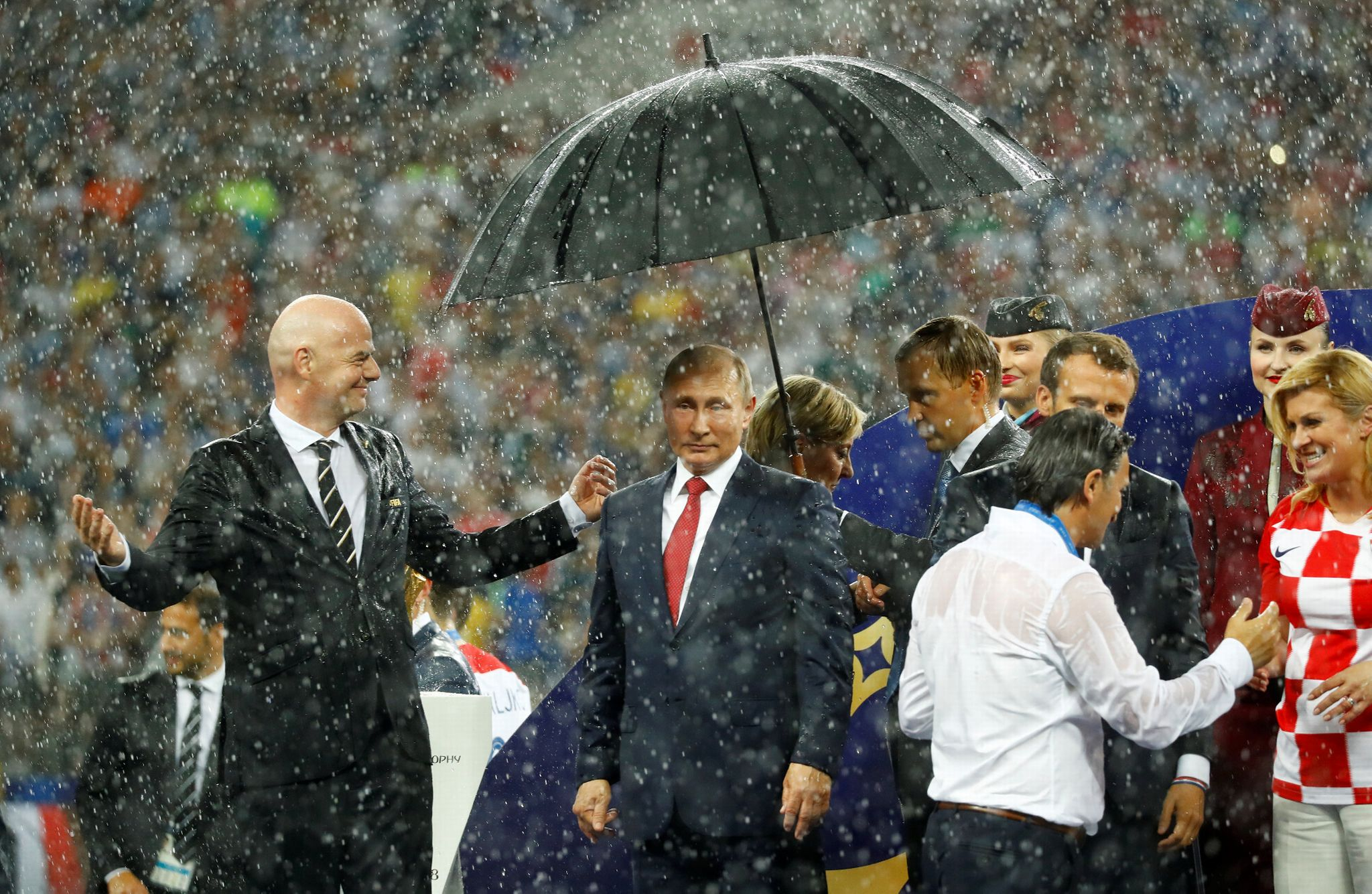 World Cup 2018: Putin gets his own umbrella as world pioneers get doused in rain