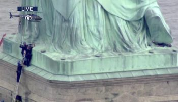 Lady climbs Statue of Liberty to dissent family partitions, prompts departure on July 4