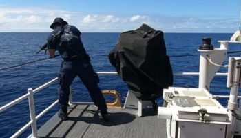 U.S Coast Guard open fire at shark to save crew watch video