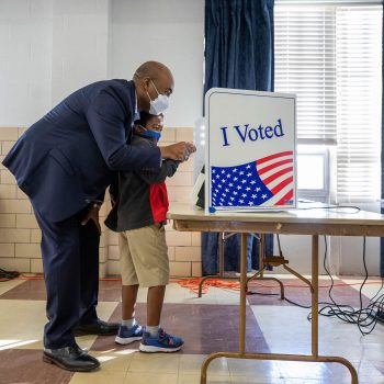 Senate candidate Jaime Harrison votes with his son, William, 6, at the Masonic Temple in Columbia, S.C. on Oct. 19, 2020.