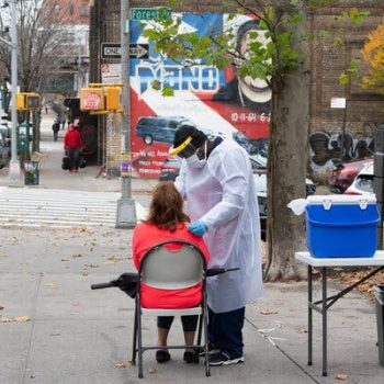 A nurse, Lenny Menye, taking a sample at a mobile virus testing site in the Bronx on Thursday.