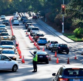 Lines of vehicles entering and exiting Dodger Stadium for coronavirus testing on Friday in Los Angeles, on a day the United States reported a record number of new cases.