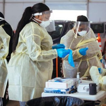 Health care workers at a virus testing site on Thursday in Milwaukee.