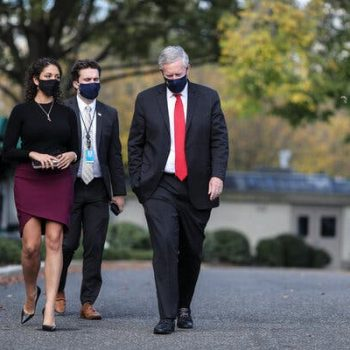 The White House chief of staff, Mark Meadows, right, in October. Mr. Meadows tested positive for the coronavirus in early November.