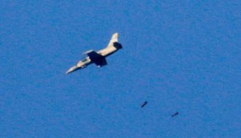 A warplane drops bombs on the southwestern Syrian province of Daraa in 2018 - AFP