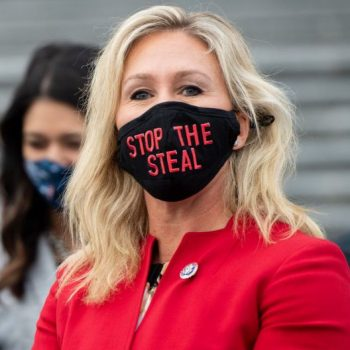 """<p>US Representative Marjorie Taylor Greene, Republican of Georgia, wears a """"Stop the Steal"""" mask on the steps of the US Capitol in Washington, DC</p> (AFP via Getty Images)"""