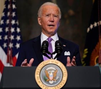 Biden news – live: Domestic terrorism alert over 'heightened threat', as president unveils climate policy
