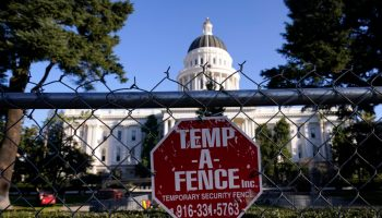 State capitols from Sacramento to Atlanta fenced off, patrolled by troops ahead of protests planned Sunday