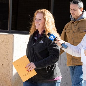 In this Wednesday, Jan. 13, 2021 file photo, Jenny Cudd, a flower shop owner and former Midland mayoral candidate, and Eliel Rosa leave the federal courthouse in Midland, Texas.  (Jacob Ford/Odessa American via AP, File)
