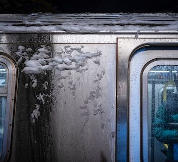 A man waits to alight from a New York City subway car covered with ice during a snowstorm, Monday, Feb. 1, 2021, in New York. (AP Photo/Wong Maye-E)