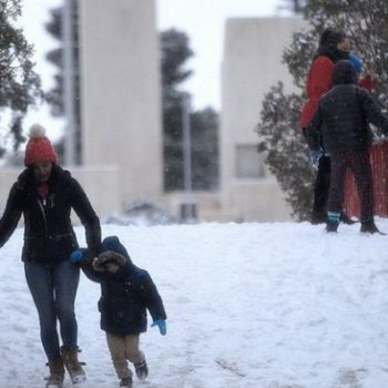 People have fun in the snow, in Ciudad Juarez, in the state of Chihuahua, Mexico, 14 February 2021