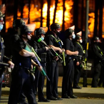 Echo Park fenced off following clashes between police, protesters; remaining homeless given 24 hours to leave