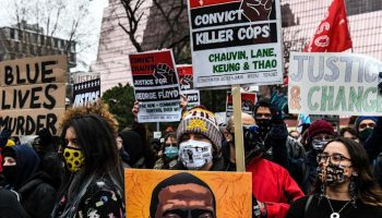 <p>People protest outside of the Courthouse during the trial of former Minneapolis police officer charged with murdering George Floyd in Minneapolis, Minnesota on 19 April, 2021</p> (AFP via Getty Images)