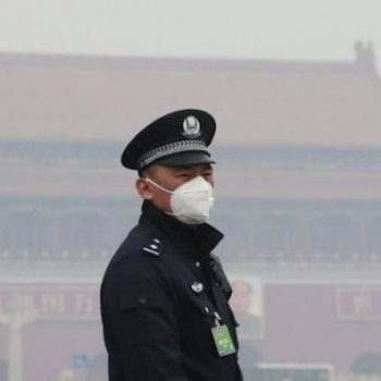 An officer wears a mask in Beijing