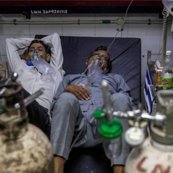 Patients suffering from the coronavirus disease (COVID-19) get treatment at the casualty ward in Lok Nayak Jai Prakash (LNJP) hospital, amidst the spread of the disease in New Delhi,