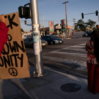 Joyce Robertson, right, clenches her fist at the intersection of Florence and Normandie Avenues in Los Angeles, on April 20, 2021, after a guilty verdict was announced at the trial of former Minneapolis police Officer Derek Chauvin for the 2020 death of George Floyd. (AP Photo/Jae C. Hong)
