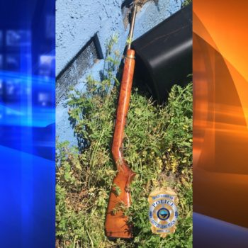 Woman armed with rifle fatally shot by police in Long Beach; man with laceration on neck found dead in home