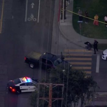 1 found fatally shot, 1 in critical condition after vehicle crashes into Fullerton structure