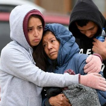 Family members mourn together
