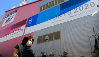 Japan pushes Olympics despite state of emergency, population that's just 1% vaccinated against coronavirus