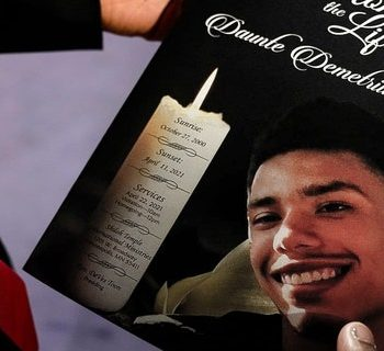 The program for the funeral services of Daunte Wright is held by a mourner at Shiloh Temple International Ministries in Minneapolis, Thursday, April 22, 2021. Wright, 20, was fatally shot by a Brooklyn Center, Minn., police officer during a traffic stop. (Associated Press)