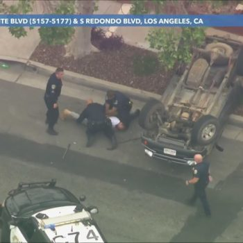 Pursuit driver taken into custody after PIT maneuver causes truck to flip over in Mid-Wilshire area