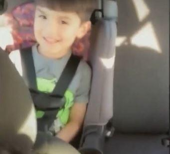 Aiden Leos in the backseat of his mother's car. The 6-year-old was shot and killed in a road rage incident in Orange County, California. (Screengrab)