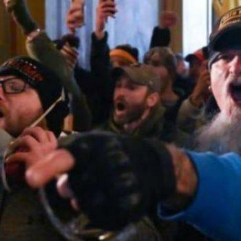 <p>Pro-Trump loyalists storm the Capitol on 6 January, 2021. </p> (FBI)