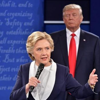 Donald Trump listens to Hillary Clinton during the second presidential debate at Washington University in St. Louis, Mo., on Oct. 9, 2016.
