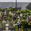 A makeshift memorial is set up near the site of the collapsed condominium in Surfside, Fla., on Monday. (AP/Miami Herald)