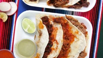 LOS ANGELES, CA - OCTOBER 17: Two mixed plates of tacos are photographed at El Ruso in East Los Angeles on Saturday, Oct. 17, 2020 in Los Angeles, CA. They serve handmade artisanal Sonoran flour tortillas and sobaqueras. (Dania Maxwell / Los Angeles Times)
