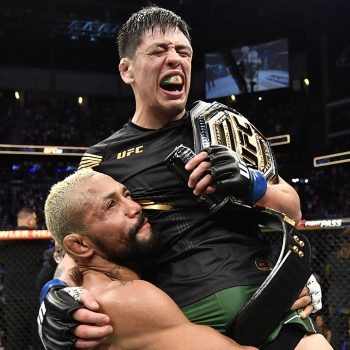 UFC's Brandon Moreno celebrates with opponent Deiveson Figueiredo after flyweight title victory
