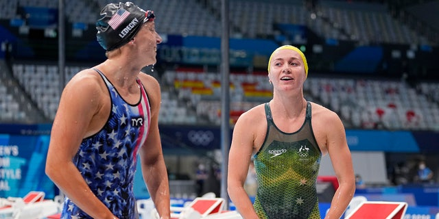 Ariarne Titmus of Australia, right, leaves the pool after winning the final of the women's 400-meters freestyle as Katie Ledecky of the United States watches at the 2020 Summer Olympics, Monday, July 26, 2021, in Tokyo, Japan. (AP Photo/Martin Meissner)