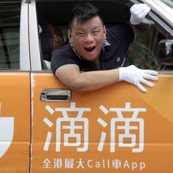 Ng Shu-kei, City Manager of Didi Chuxing Hong Kong, poses in a taxi at Jordan.