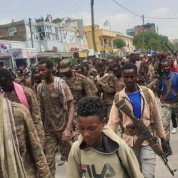 Ethiopian government soldiers and prisoners of war in military uniforms walk through Mekelle, 2 July