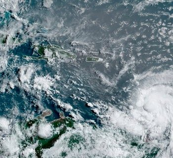This satellite image provided by the National Oceanic and Atmospheric Administration shows Hurricane Elsa moving through the Caribbean, over Barbados. Elsa was expected to pass near the southern coast of Hispaniola on Saturday and to move near Jamaica and portions of eastern Cuba on Sunday. (Associated Press)