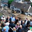 German Chancellor Angela Merkel, rear third left, visits flood-ravaged areas to survey the damage and meet survivors after days of extreme downpours and devastating floods in Germany and other parts of Western Europe.