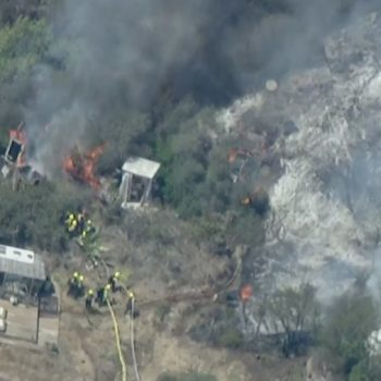 More than 100 firefighters battling Flores Fire threatening structures in Topanga