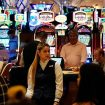 Crowds walk through the casino during the opening night of Resorts World Las Vegas in Las Vegas on June 24, 2021. (AP Photo/John Locher, File)