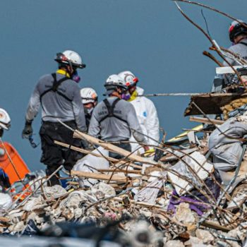 Search and rescue teams search the rubble of the partially collapsed 12-story Champlain Towers South condo building in Surfside, Florida, on July 2.