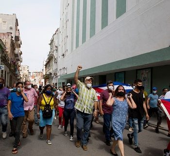 Backers of the government march in Havana, Cuba, Sunday, July 11, 2021. Hundreds of supporters of the government took to the streets while hundreds protested against ongoing food shortages and high prices of foodstuffs. (AP Photo/Ismael Francisco)